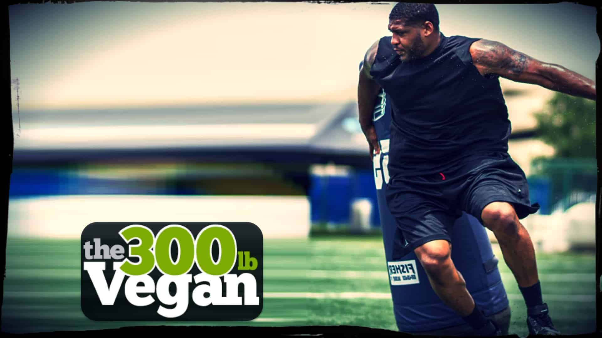 """Defensive lineman David Carter is shown in training skimming past a tackle dummy. In a lower left inset the words """"The 300 pound Vegan"""" are displayed."""