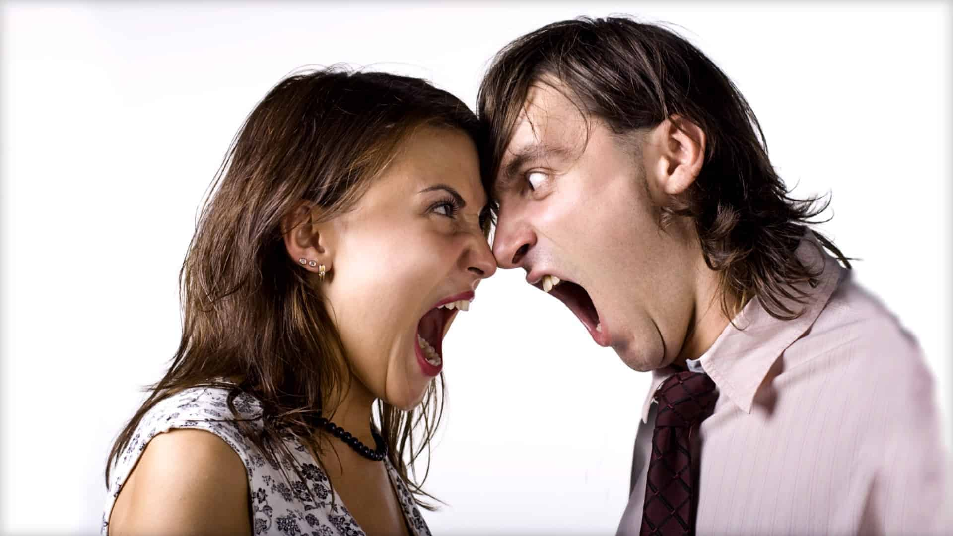 Two people are shown, in each other's face, screaming and angry.