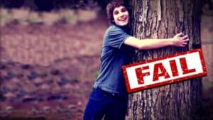 """A person with their arms wrapped around a wide tree trunk. The word """"FAIL"""" is stamped in red overtop the image."""