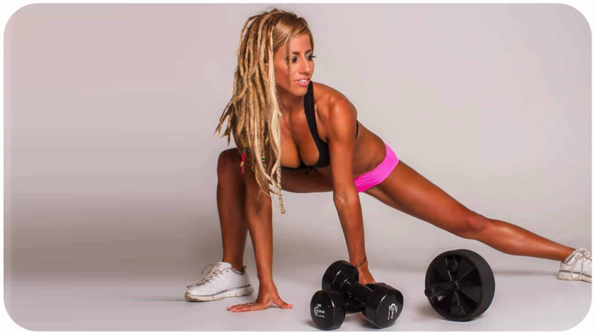 Vegan body builder Crissi Carvalho is seen in a body building pose showing an incredibly toned body .