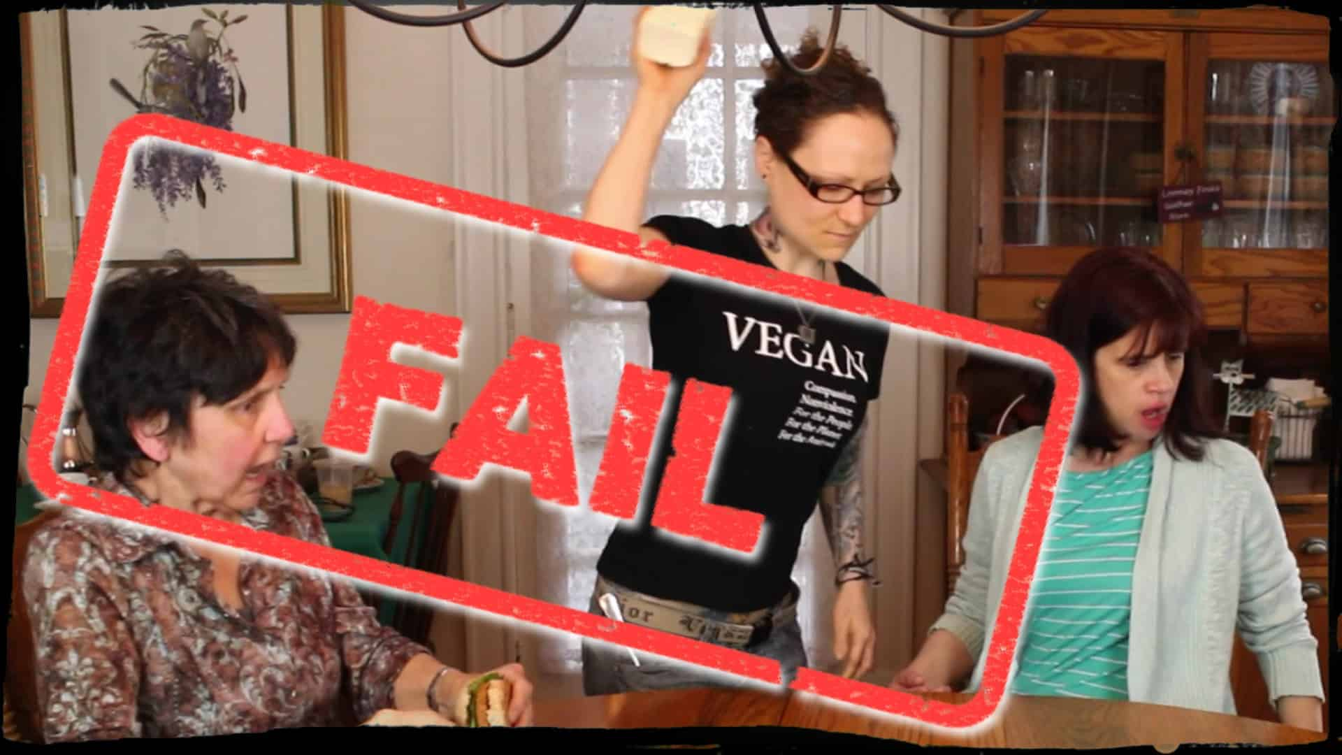 """Around a dining table two people are seated with looks of alarm upon their faces. Emily Moran Barwick of Bite Size Vegan is seen in the process of throwing a large block of tofu onto the middle of the table. Overlaying the image, as if stamped upon it, is the word """"Fail""""."""