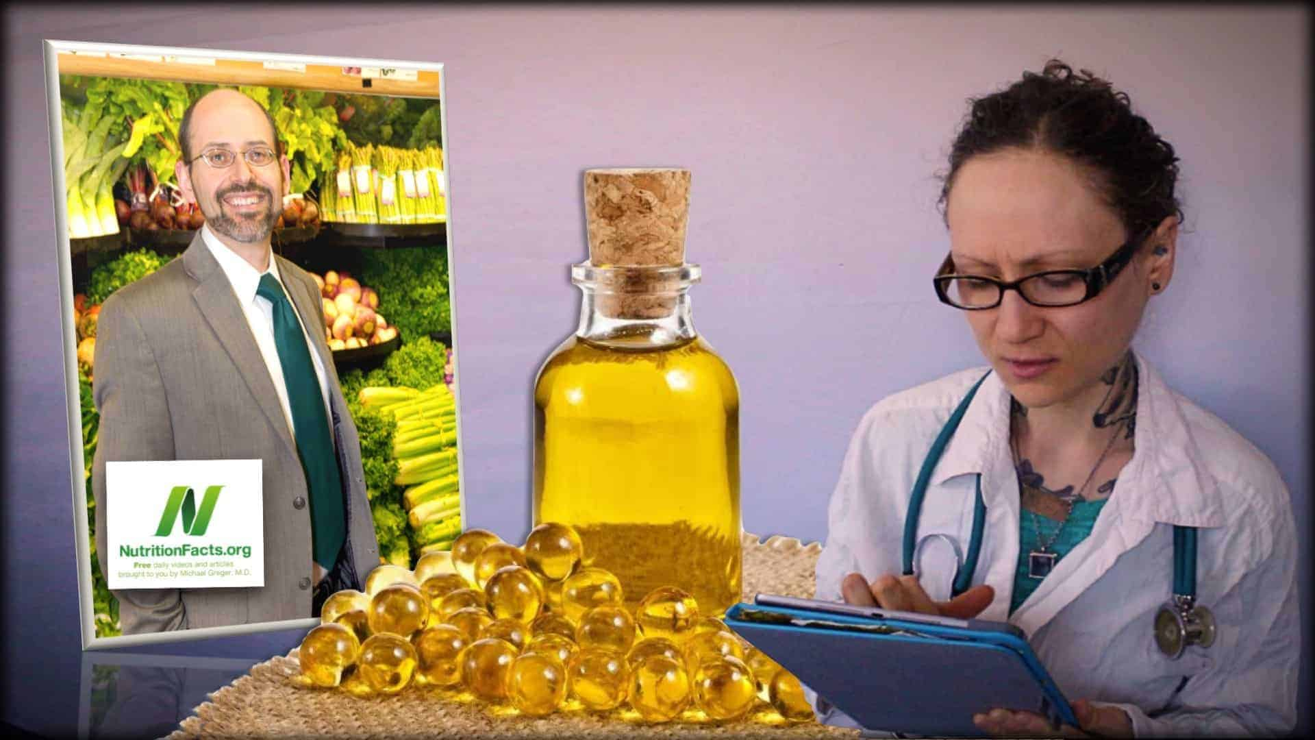 Dr. Greger of NutritionFacts.org is seen as an inset photograph on the left. In the center is a bottle of cod liver pills and some cod liver oil tablets. On the right is an image of Emily Moran Barwick of Bite Size Vegan wearing a doctors coat, complete with stethoscope entering data into a tablet computer.