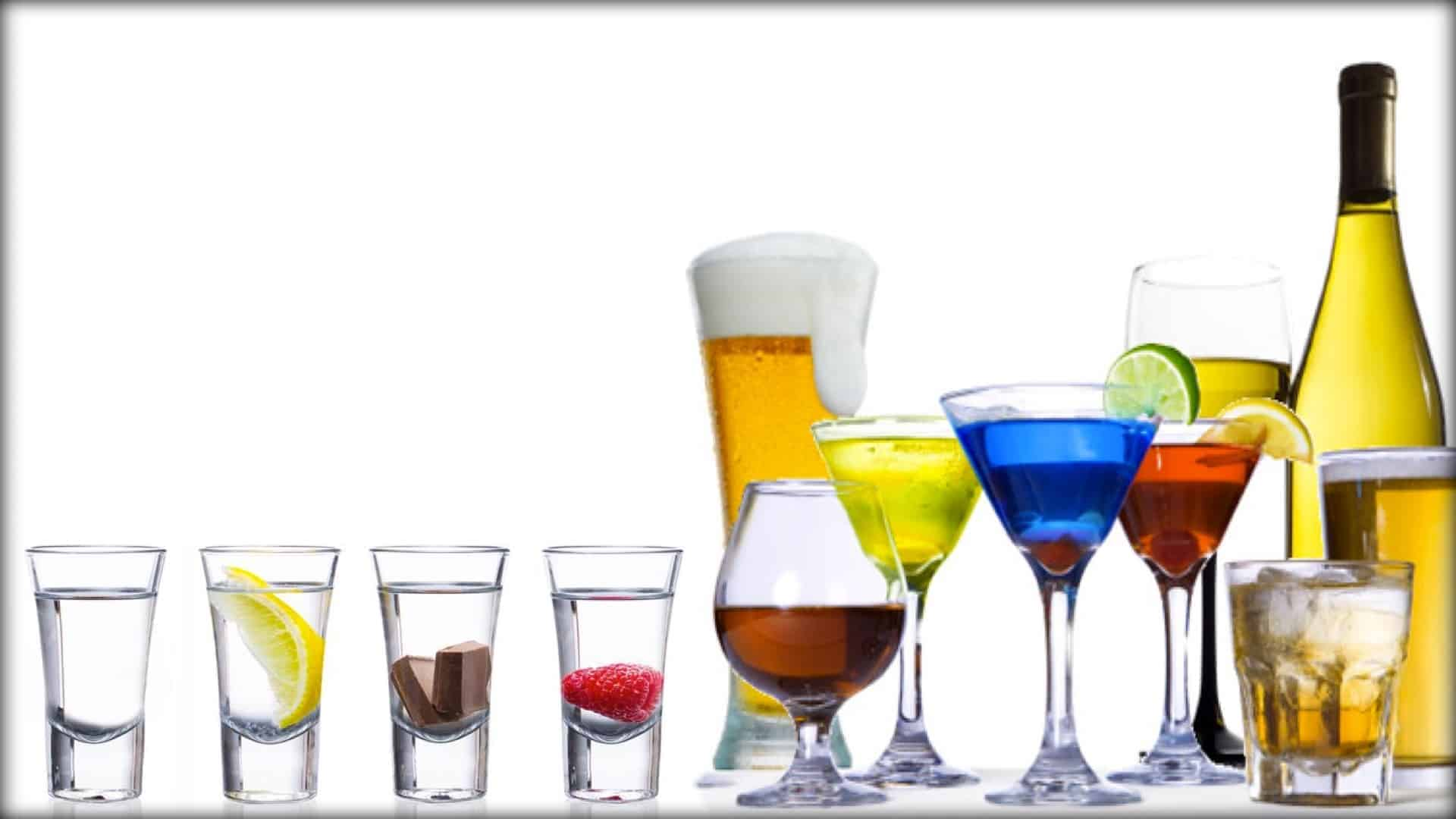 A range of different and colorful alcoholic beverages are displayed in a line.