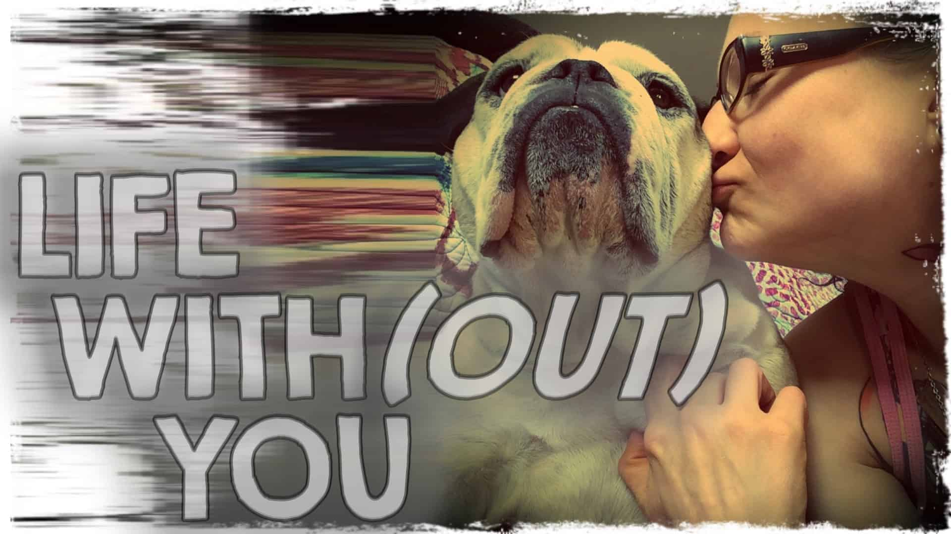 """Emily Moran Barwick of Bite Size Vegan is shown in close-up kissing her beloved Ooby. Overlaying the image are the words """"Life with(out) you""""."""