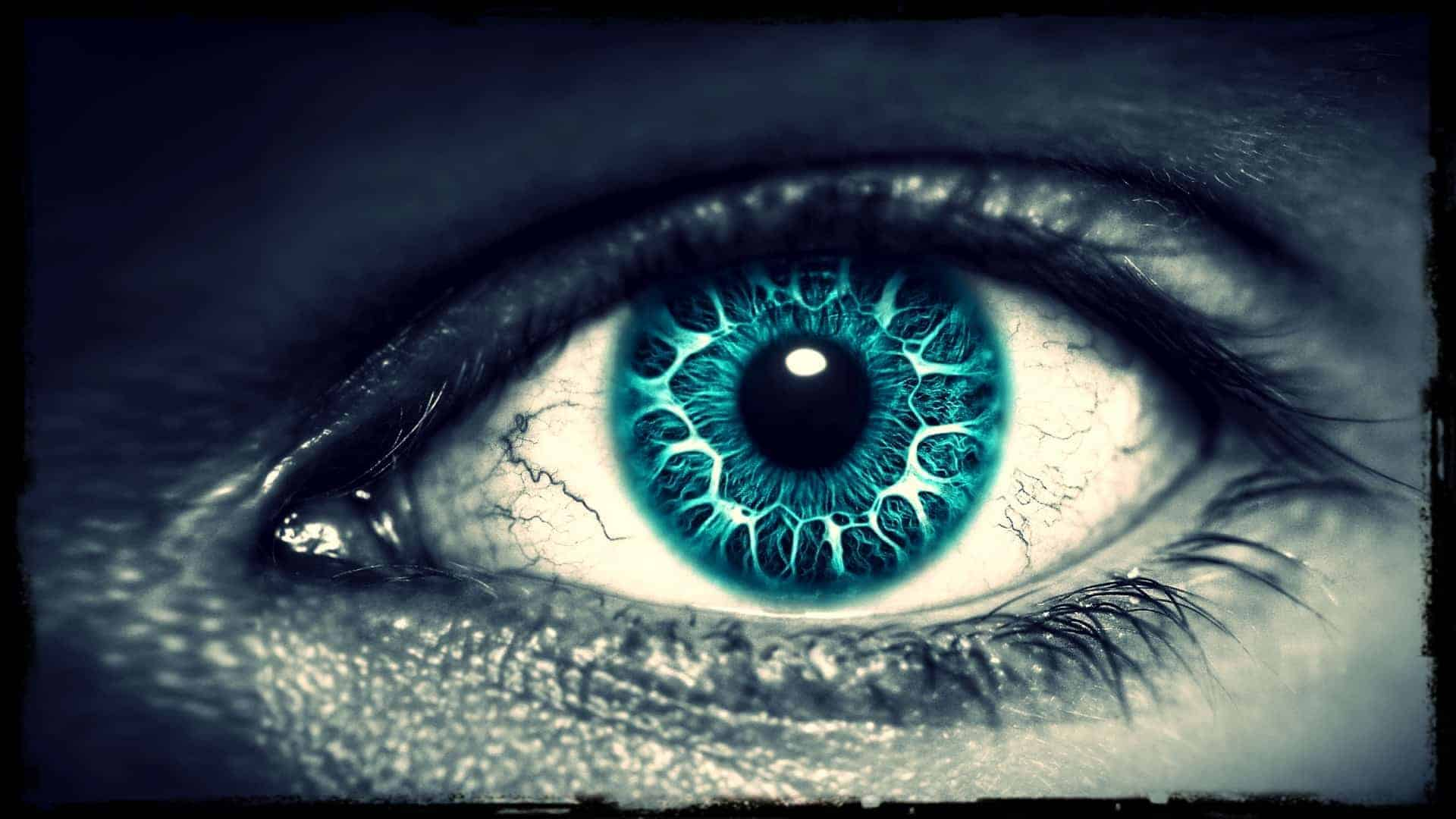 A close-up of a human eye is shown. There is a surreal color to it. The iris is vibrant.