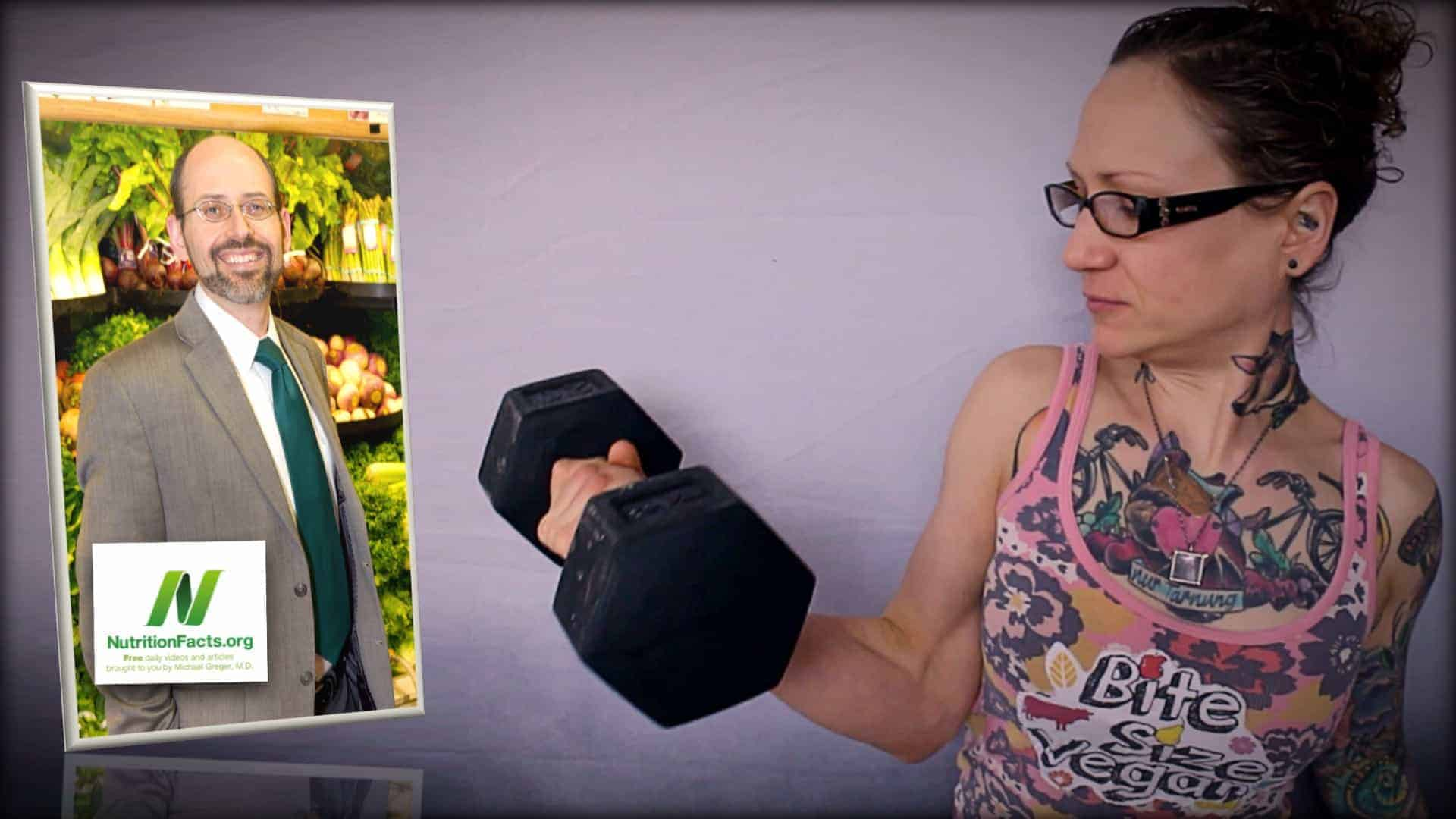 Dr. Greger of NutritionFacts.org is seen as an inset photograph on the left. On the right, Emily Moran Barwick of Bite Size Vegan is seen carrying out an arm curl with a large iron dumbbell.