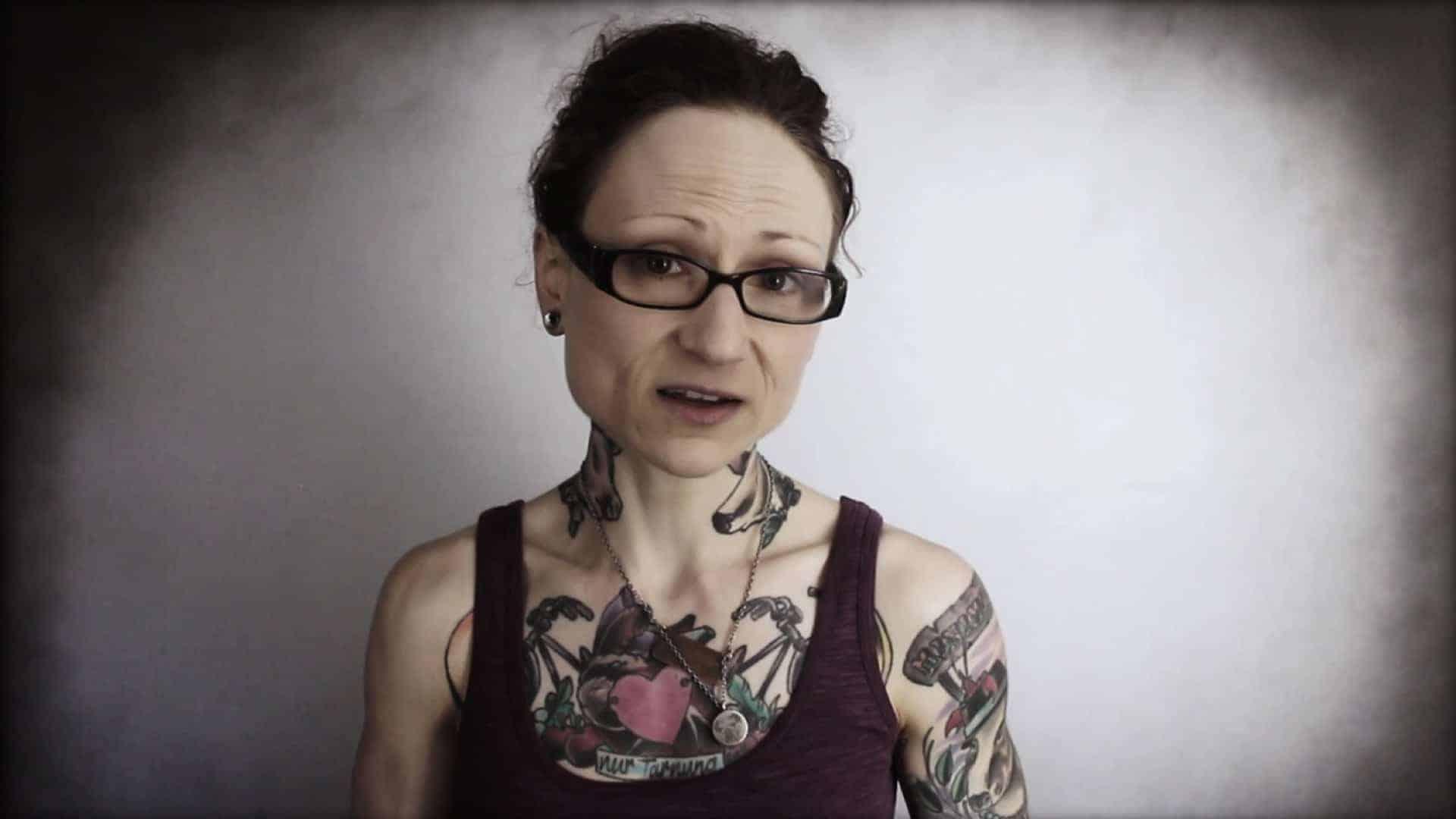 Emily Moran Barwick of Bite Size Vegan is shown looking into the camera.