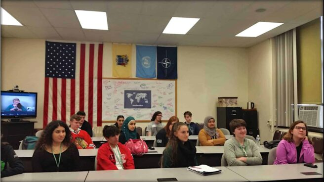 Emily Moran Barwick of Bite Size Vegan speaking over video conference to the students in Contemporary Issues Through Video Conferencing class at Passaic Valley Regional High school in New Jersey about the animal products industry's influence in government.