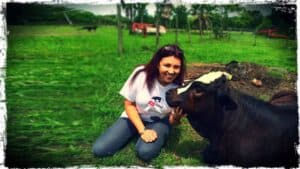 Renee King-Sonnen of Rowdy Girl Sanctuary is shown with Houdini, a beautiful calf.