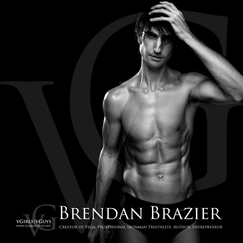 Brendan Brazier former endurance athlete, author, advocate of a vegan diet, and creator of the Vega line of food products and supplements, in a speedo with his left hand on his head on a black background with his name in white lettering