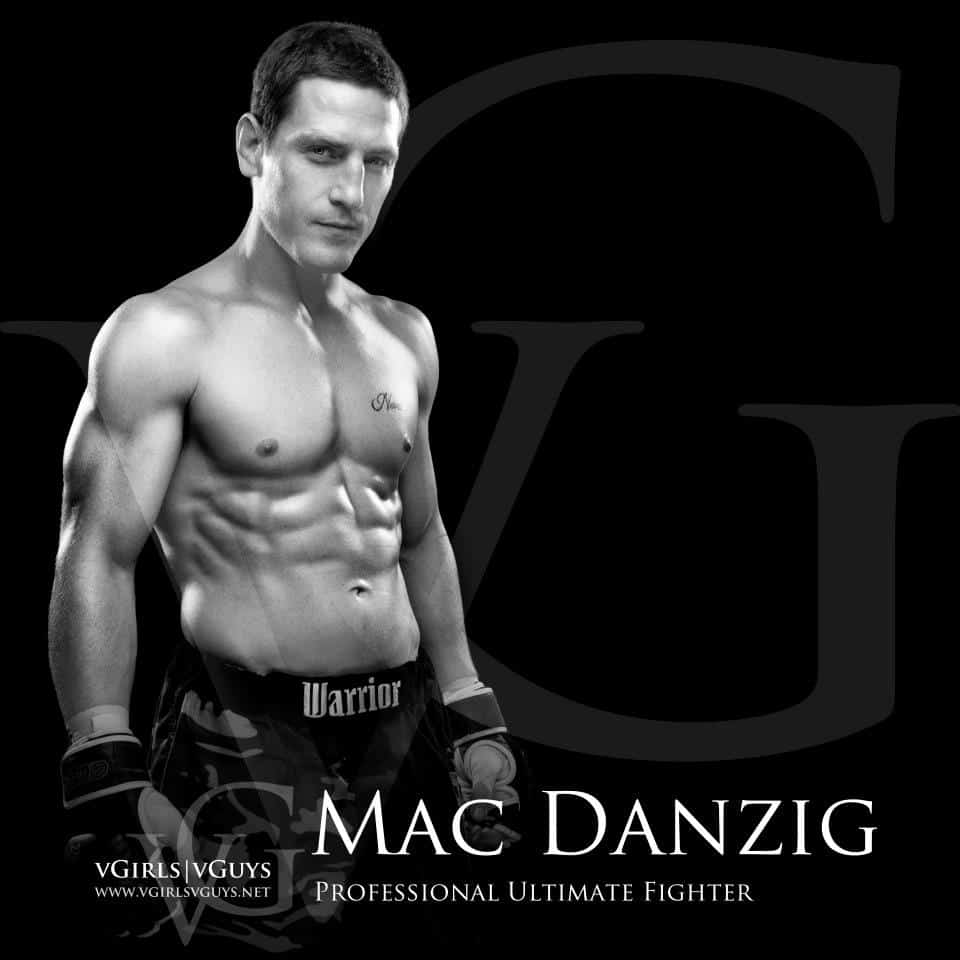 Mac Danzig professional ultimate fighter standing in boxing shorts and gloves with arms at his side, on a black background with his name in white lettering